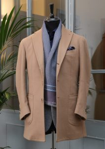 - a chesterfield look-like coat made by camel-color cashmere with horn buttons