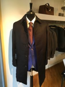 a loden look-like coat made by waterproof navy cashmere with beaver fur lining and horn buttons