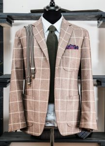 a single-breasted jacket in windowed flannel wool fabric with notch lapel and patch pockets