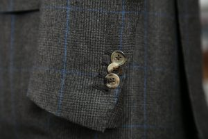hand sewn buttonholes and horn buttons