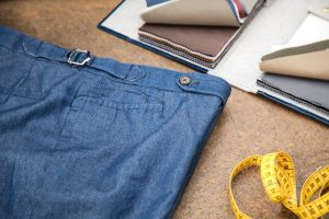 trousers in blue denim cotton with extended waistband, horn buttons and side buckles