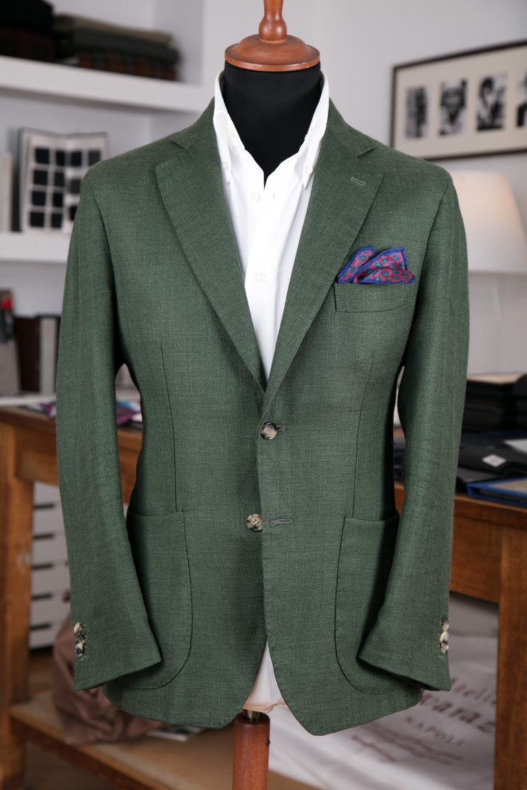 a single-breasted jacket in green linen/silk fabric with horn buttons, notch lapel and patch pockets