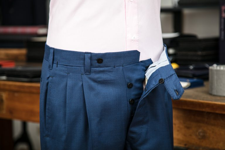 a double pleats trousers in blue tasmanian wool fabric with belt-loops